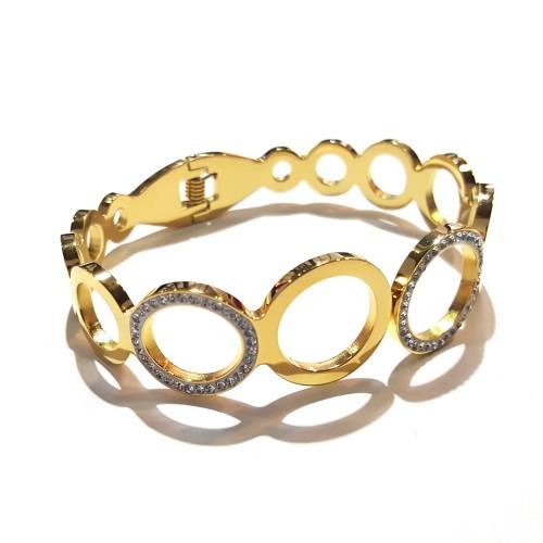 Bracelet fermé anneaux dorés et strass